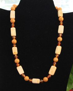 """Beige and orange beaded necklace. 9""""L."""