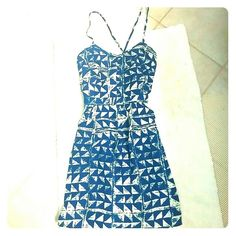 Francesca's geo print sundress Blue and white graphic triangle print sundress. Worn twice. Crossed back straps with back zip. Size M, fits like 6-8. Francesca's Collections Dresses