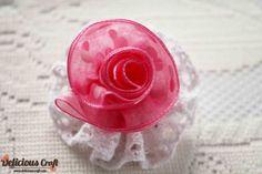 Read the tutorial here: http://deliciouscraft.com/2013/02/polkadot-rose-tutorial/#
