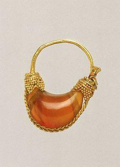 Gold and carnelian boat-shaped earring. Period: Classical Date: 5th–4th century B.C. Culture: Greek Medium: Gold, carnelian Dimensions: 15/16in. (2.4cm)