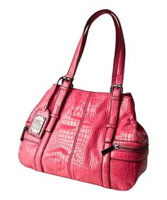 A handbag is an extension of our personal style, and a tote makes a trendy option. This chic carryall features two exterior pockets, a logo luggage tag and two interior slip pockets for sunglasses and cell phones.10.75'' W x 10.5'' H x 5.75'' DPVCImported