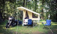Mini Mate pull behind motorcycle pop up camper at the campsite