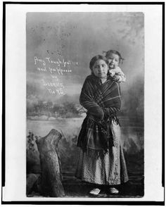 Dedrick, J. V., 1909.  Amy Tough-Feather and papoose.