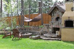Backyard sweet backyard with fire pit, hammock fire place and lots of seating.