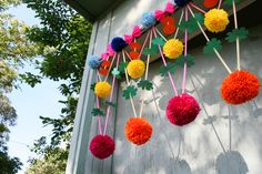 In Poland, traditional craftspeople make colourful mobiles from paper and pom poms called Pajaki (or Polish Chandeliers) to adorn their homes. We love the look of these beautiful creations and decided to put our own little spin on the idea by making this bright, summery hanging decoration.