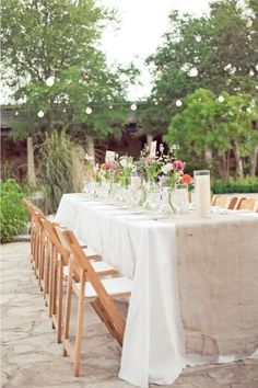 Burlap table runner with natural wood chairs; great for beach themed or outdoor weddings!