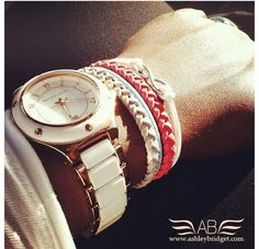 Braided leather braclets and a huge, classy office watch. LOVE.