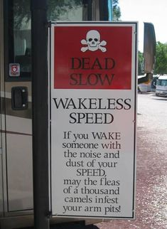 """Campground sign that reads """"Dead slow, wakeless speed. If you wake someone with the noise and dust of your speed, may the fleas of a thousand camels infest your arm pits"""""""