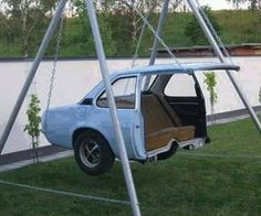 Someone took a back seat of an old car and made a beastly looking swing! So want this!