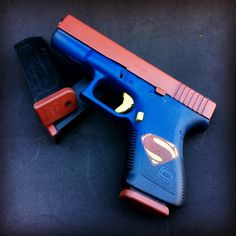 Superman Glock 23 done in DuraCoat by Gun Ink Designs. @guninkdesigns #duracoat #superman #glock