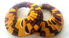 Check out this item in my Etsy shop https://www.etsy.com/listing/256162007/yellow-red-ankara-hoop-earrings
