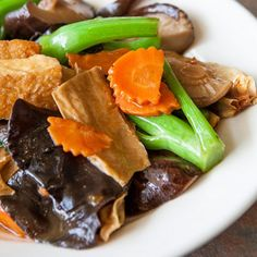 A delight of textures and flavors with carrots, Chinese broccoli, fried tofu, shiitake, wood ear fungus and dried beancurd skins.