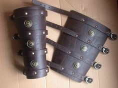 Leather bracers. #armor Leather Bracers, Leather Cuffs, Leather Working, Metal Working, Arm Guard, Viking Clothing, Armor Concept, Belt Buckles, Armour