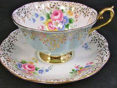 ROYAL ALBERT LIGHT BLUE PASTEL GOLD FLORAL TEA CUP AND SAUCER