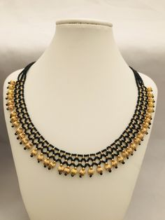 Bunch of small black beads chains with gold balls Handmade jewelry Silver plated jewelry Pearl Necklace Designs, Gold Earrings Designs, Beaded Necklace, Beaded Jewelry, Gold Necklace, Gold Jewelry Simple, Gold Jewellery, Gold Mangalsutra Designs, Gold Bangles Design