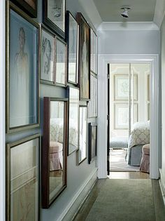 beautiful hallway with gallery wall
