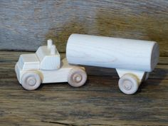 Handmade original design wood tanker milk truck. 6 3/4 inches long and 1 3/4 inches wide, wheels all turn and cab and trailer detach. Made from
