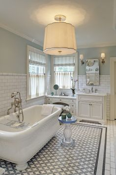 The paint color is Farrow & Ball Borrowed Light. It's a great bathroom paint color - the same color as water.