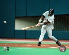 Tony Gwynn # 19 of the San Diego Padres gets his 3000th hit with a single in the first inning against the Montreal Expos at Olympic Stadium. August 6, 1999. Photo Print (8 x 10)