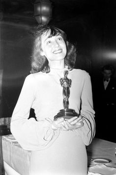 Luise Rainer is the first woman to win two Oscars. She holds her Academy Award for Best Actress for her performance in The Great Ziegfeld during the 1937 Academy Awards ceremony.