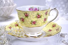 Vintage Royal Albert Tea Cup and Saucer Set, Pink Rosebuds over Pale Yellow Band, Gold Gilt Trim, Made in England, 1940s by TeacupsAndOldLace on Etsy https://www.etsy.com/listing/613342502/vintage-royal-albert-tea-cup-and-saucer