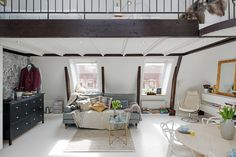 swedish-apartment-white-and-exposed-wood-beams