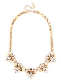 Metallic half-moon shapes evoke futuristic artifacts, featuring triangular gem embellishment for a warrior-cool statement necklace.