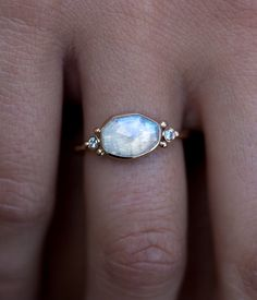 A beautiful, iridescent moonstone and two 3 pt. side diamonds are sure to add a little extra shimmer and sparkle to every outfit in your wardrobe. This elegant piece is set in a 14k Yellow Gold band t