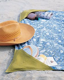Keep track of beach essentials -- sunscreen, novels, flip-flops -- by sinking them in a corner pocket. To make four pockets, take a sheet or a lightweight blanket and two 14-inch squares of linen or cotton. Cut each square into two triangles. Fold all edges over 1/2 inch, and press. Fold long edge of each triangle over another 1/2 inch, and sew across to hem. Pin the triangles to the corners of the blanket. Sew the short sides of the triangles to the blanket's corners...