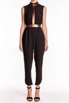 Gleaming bronze panels and a dramatic open back give an alluring touch to the contemporary Estate Jumpsuit by Camilla & Marc. This sleeveless, ankle length black jumpsuit features a notched high neckline and leg openings, on-seam side pockets, partial lining, and buttoned and concealed zipper closures in the back.   http://www.isaay.com/Camilla-Marc-Estate-Jumpsuit/CAM-106229,default,pd.html?dwvar_CAM-106229_color=ZBL=8=new-clothing=Price%20%28High%20to%20Low%29