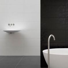 white tile grid next to gray floor White Wall Tiles, Grey Floor Tiles, White Subway Tiles, Grey Flooring, Gray Floor, Large Tile Bathroom, White Bathroom, Upstairs Bathrooms, Vinyl Tiles