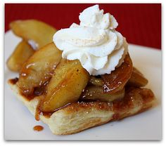 Sugar and cinnamon puff pastry turned into waffle pastries, topped with caramelized apples and cinnamon whipped cream. How to photographs included.