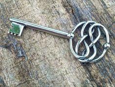 AURYN Key Pendant STAINLESS Never Ending Story Infiniti Knot. $55.00, via Etsy.