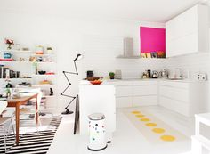 White kitchen with a big pop of magenta in the cabinet interior. Fun black floor lamp for lighting and small pop of yellow in the carpet. Modern and minimal Eclectic Kitchen, Kitchen Interior, Kitchen Decor, Kitchen Design, Kitchen Runner, Beautiful Kitchens, Cool Kitchens, White Rooms, Cuisines Design
