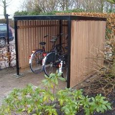 The bicycle cellar is available with or without doors. This bicycle storage … - Innen Garten - Eng Garden Bike Storage, Outdoor Bike Storage, Backyard Storage, Bicycle Storage, Garage Velo, Bike Shelter, Corner Garden, Bike Shed, Small Garden Design