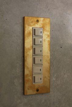 Custom brass switch plate by Uno Tomoaki