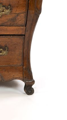 A Louis XV Provincial walnut bombe commode, mid 18th century. Serpentine top above undulating drawer fronts with snail scroll ornamentation on a conforming apron above scrolled cabriole feet, Circa 1750. height: 34 in. 86 cm., width: 49 in. 124.5 cm., depth: 23 in. 58.5 cm. #rocaille #louisxv #frenchprovincial #louisxvfurniture #commode #vintagecommode #frenchantiques #sf #sanfrancisco #scrollingfeet #scrolledfoot #vintage #maximalism #maximalist #maximalistdecor #interiordesign