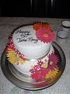 A Fall inspired cake decorated with Gerbera daisies for my husband's parents 50th Anniversary.
