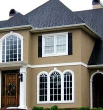 tan stucco white window moldings