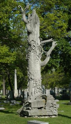 At first, this appears to be an ordinary limestone tree monument, a common type found in hundreds of places. However, at its base is something unique - a railroad car entering a tunnel.  Rosehill Cemetery, Chicago