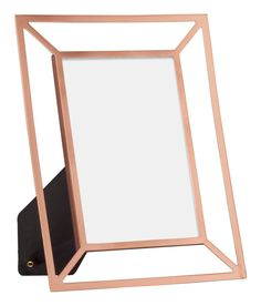 Avoid extra clutter by choosing decor with open lines, like this blank-space picture frame. | 32 Pieces Of Decor That'll Make Your Home Look So Much Bigger