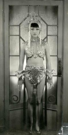 """The American actress Anna May Wong (1905-1961) in her role as a belly dancer in the movie """"Hai Tang"""". Place and date unknown."""