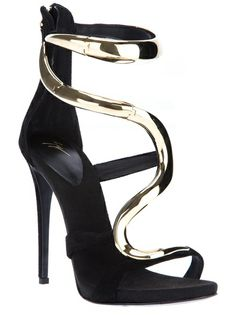 Black sandals from Giuseppe Zanotti Design featuring an open toe, a gold tone snake effect panel to the front and ankle, black strap details, a zip back fastening and a high stiletto heel. #farfetch