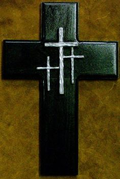 Like the center hammered metal cross (prefer it not shiny though) for the center of a rustic wooden cross, not shiny black