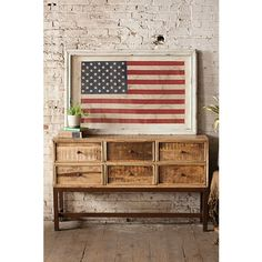 This largeAmerican flag adds a dose of patriotic color to an otherwise basic corner.   - HouseBeautiful.com