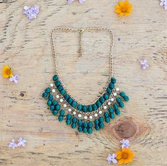 This Tuli statement necklace is handmade in Uganda and fights poverty with every purchase. Tuli's fair trade products create sustainable, fair-waged jobs in Uganda as a long-term solution to poverty.