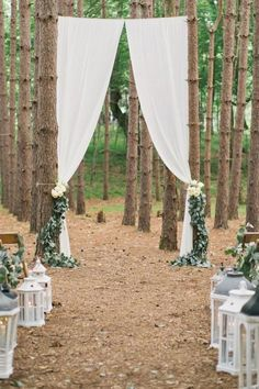Want to make a grand entrance? Make the perfect outdoor entryway with long drapes hanging for your big reveal.Related: 100 Beautiful Outdoor Wedding Ceremonies
