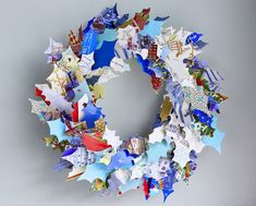 wreath made from old xmas cards. With a cutout xmas shape