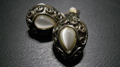 Vintage Silver and White Teardrop Clip-On Earrings. by TheLatibule on Etsy
