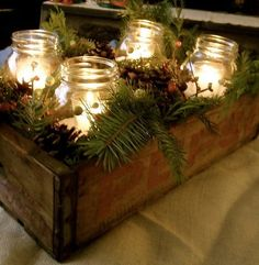 Country Christmas : mason jars with candles, evergreen, rustic - use the flower box with rope handles. Clean, stain and use as decoration. Decoration Christmas, Christmas Lanterns, Christmas Mason Jars, Noel Christmas, Rustic Christmas, Winter Christmas, Vintage Christmas, Holiday Decorating, Decorating Ideas